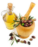 Olive oil and olives. In an mortar  over white background Royalty Free Stock Photography