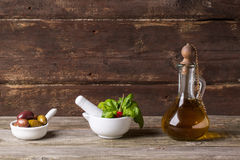 Olive oil with olives and basil Stock Image