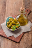 Olive oil and olives in bowl Royalty Free Stock Images