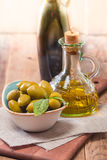 Olive oil and olives in bowl Stock Photos