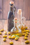 Olive oil and olives in bowl Stock Photography