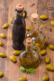 Olive oil and olives in bowl Royalty Free Stock Photo