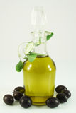 Olive oil, olives and branch Stock Photo