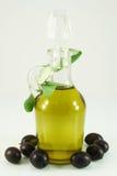 Olive oil, olives and branch. Transparent bottle of olive oil, olives and branch Stock Photo