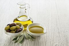 Olive oil with olives and branch Stock Photography