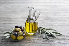 Olive oil with olives and branch Royalty Free Stock Photography