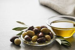 Olive oil with olives and branch royalty free stock photos