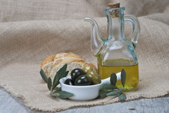 Olive oil with olives and bread Royalty Free Stock Image