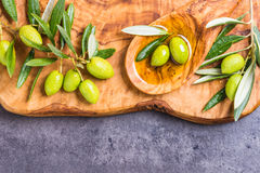 Olive oil and olives copy space. Stock Image