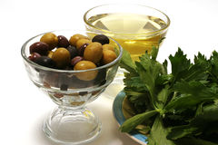 Olive oil, olives and green salad Royalty Free Stock Image