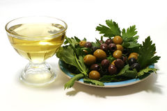 Olive oil, olives and green salad Stock Photos
