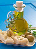 Olive oil with olives and herbs Stock Image