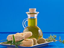 Olive oil with olives and herbs Royalty Free Stock Images
