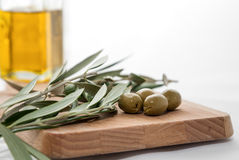 Olive oil with olives isolated on white background Stock Photos