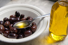 Olive oil and olives on marble Stock Photography