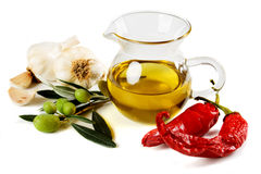 Olive oil with olives, peppers and garlic Royalty Free Stock Images