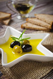 Olive oil and olives Stock Images
