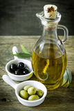 Olive oil. And olives on the table Stock Photography