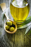 Olive oil. And olives on the table Stock Photo
