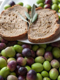 Olive oil and olives on the table. Olive oil and olives on white table stock images