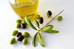Olive Oil and Olives VII. Olive Oil and Olives with great colors in white background Stock Photos