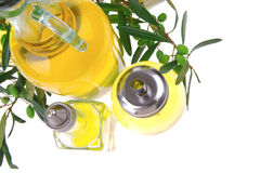 Olive oil and olives on white Stock Photography