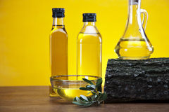 Olive oil and olives on wood Stock Photo