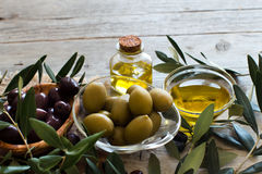Olive oil and olives on wood background Royalty Free Stock Images