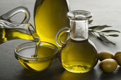 Olive oil pouring to bowl close up royalty free stock image