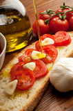 Olive oil over bruschetta Stock Photography