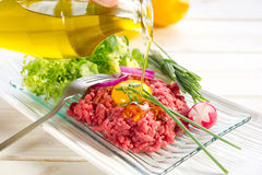 Olive oil  over tartare Stock Photography