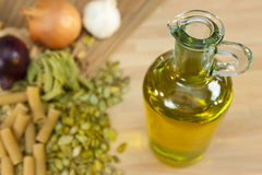 Olive Oil, Pasta, Onions and Garlic Royalty Free Stock Photo