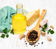 Olive oil, pepper, cheese and garlic Royalty Free Stock Photo