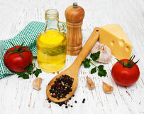 Olive oil, pepper, tomato, cheese and garlic Royalty Free Stock Photo