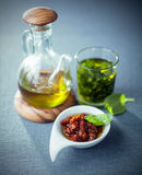 Olive oil, pesto and piquant tomato dip Royalty Free Stock Photo