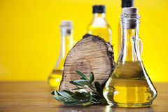 Olive oil and piece of wood Royalty Free Stock Photo