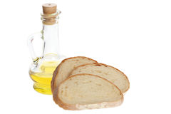 Olive oil and pieces of bread Royalty Free Stock Images
