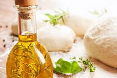 Olive oil and pizza dough Royalty Free Stock Image