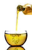 Olive Oil Poured. Into a bowl on white Royalty Free Stock Photos