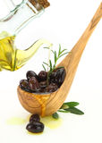 Olive Oil Poured Into A Wooden Spoon Full Of Olives Royalty Free Stock Photos