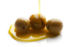 Olive oil pouring Royalty Free Stock Photos