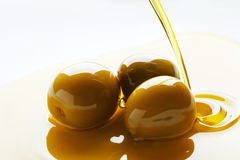 Olive oil pouring Stock Image