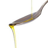 Olive oil pouring on a spoon Stock Photography