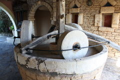 Olive oil press Stock Images