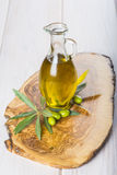 Olive oil with raw olives and leaves Royalty Free Stock Image