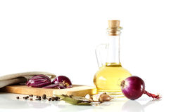 Olive oil and red onion, laurel, pepper on a white background Royalty Free Stock Image