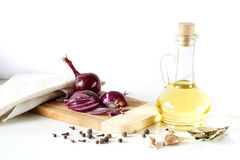 Olive oil and red onion, laurel, pepper on a white background Stock Photography