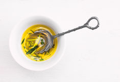 Olive oil with Rosemary in Bowl Royalty Free Stock Image