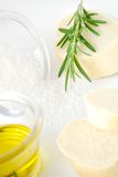 Olive oil, rosemary and bread Stock Photos