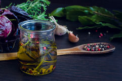 Olive oil with rosemary, garlic and pepper Stock Photos